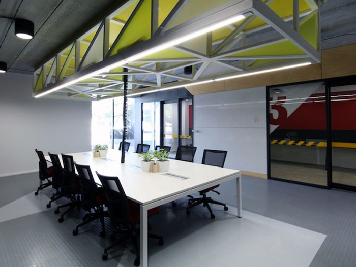 An image of a the marketing agency, Gilligan Group's new office space a long table and office chairs